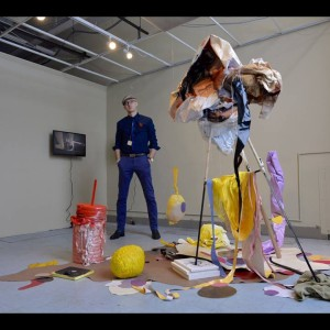 Curator Peter Gynd with artist Katya Grokhovsky's 'Uproar', 2015 Found objects, mixed media, acrylic, vinyl, towel, synthetic wigs, thread, wrapping paper, medium. plastic, rubber Dimensions variable Cultbytes